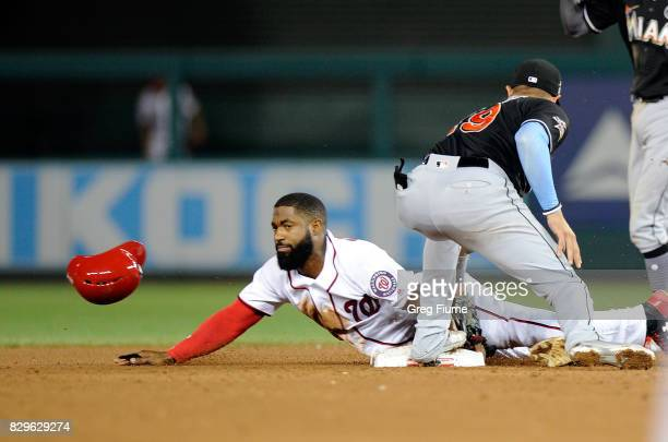 Brian Goodwin of the Washington Nationals steals second base in the sixth inning ahead of the tag of Miguel Rojas of the Miami Marlins at Nationals...
