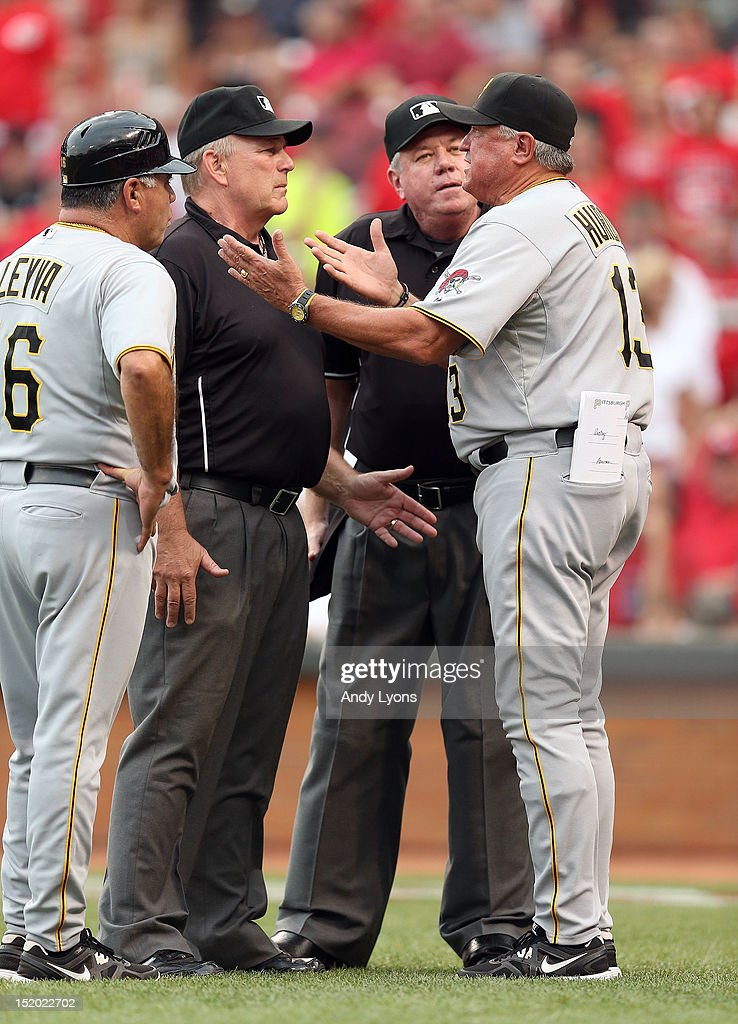 Brian Gorman the home plate umpire and Clint Hurdle the manager of the Pittsburgh Pirates have a discussion during the game against the Cincinnati Reds at Great American Ball Park on August 4, 2012 in Cincinnati, Ohio. Hurdle would eventually be ejected.