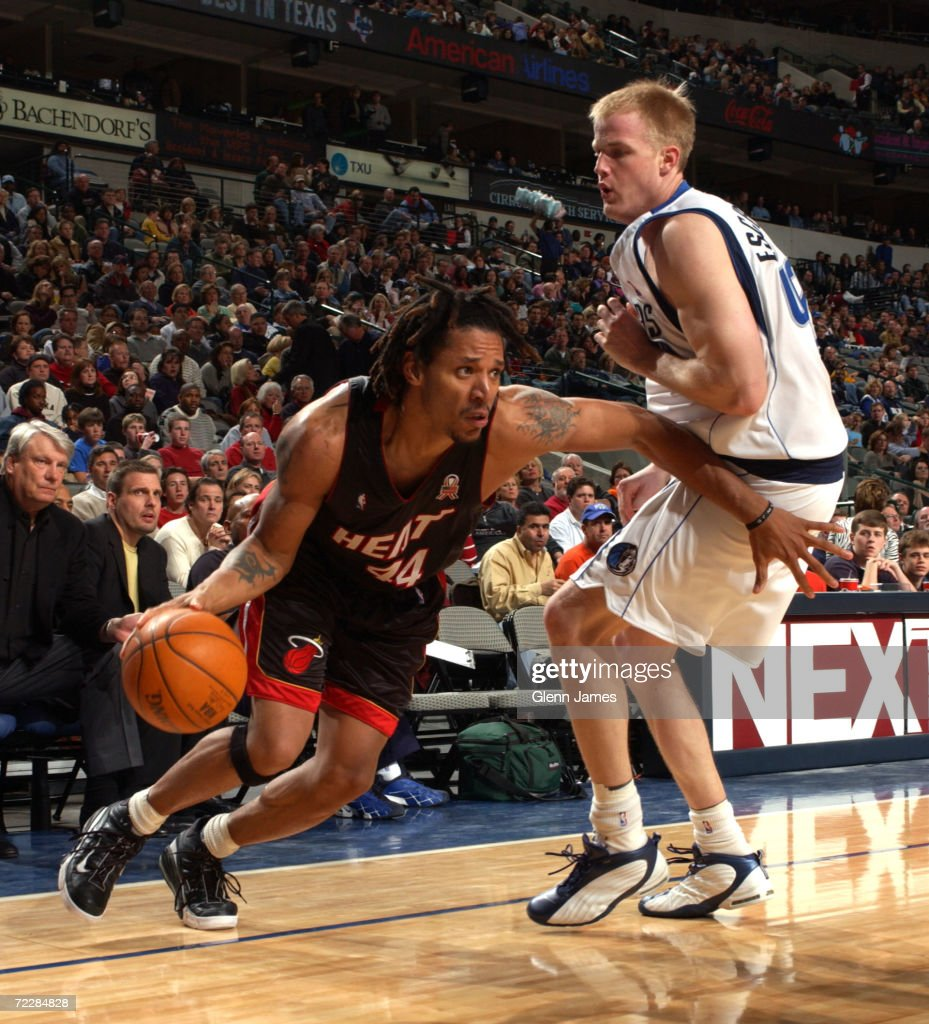 Brian Grant 44 of the Miami Heat drives against Evan Eschmeyer