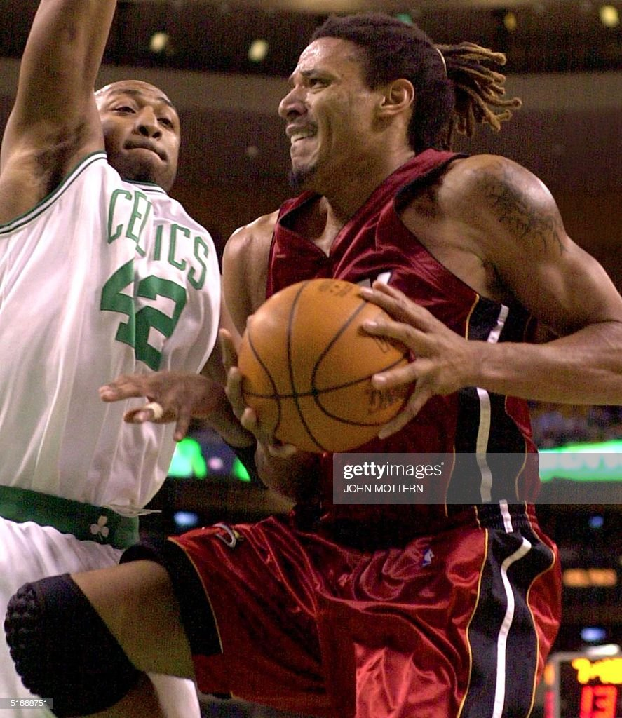Brian Grant R of the Miami Heat drives to the ba