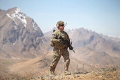 Brian Hamm from Plano Texas with the US Army's 2nd Battalion 87th Infantry Regiment 3rd Brigade Combat Team 10th Mountain Division patrols up a...