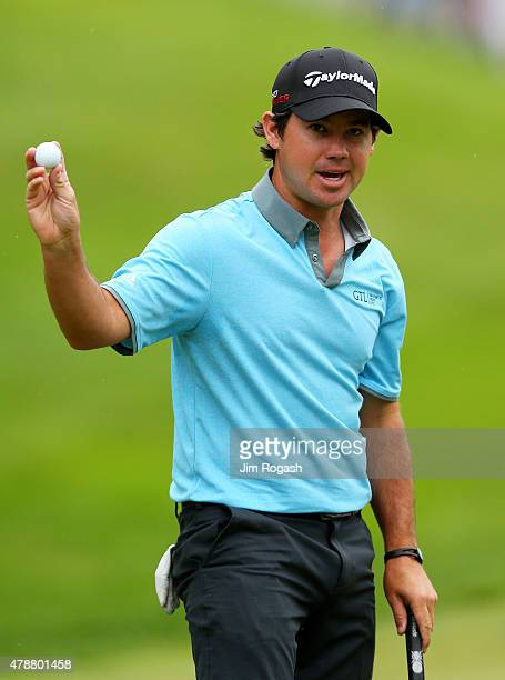 Brian Harman holds up his ball after finishing on the 18th green during the third round of the Travelers Championship at TPC River Highlands on June...