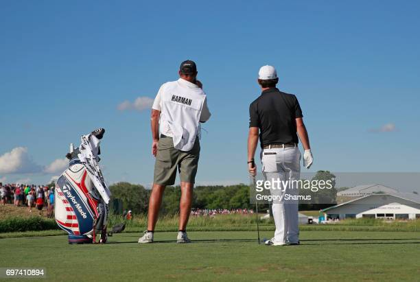 Brian Harman of the United States and caddie Scott Tway watch his shot from the 13th tee during the final round of the 2017 US Open at Erin Hills on...