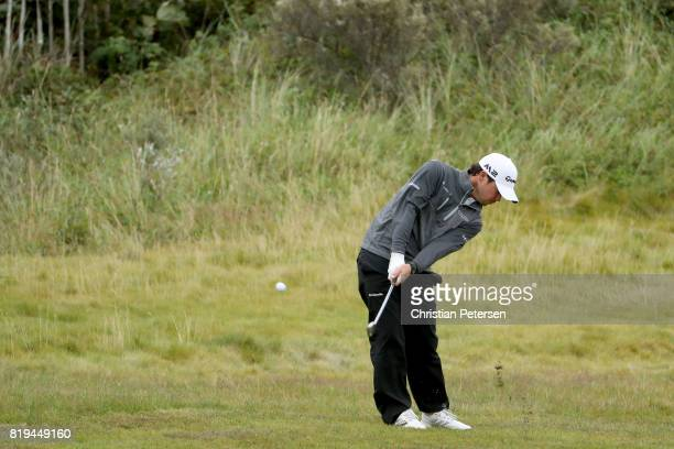Brian Harman of the United States hits his second shot on the 1st hole during the first round of the 146th Open Championship at Royal Birkdale on...
