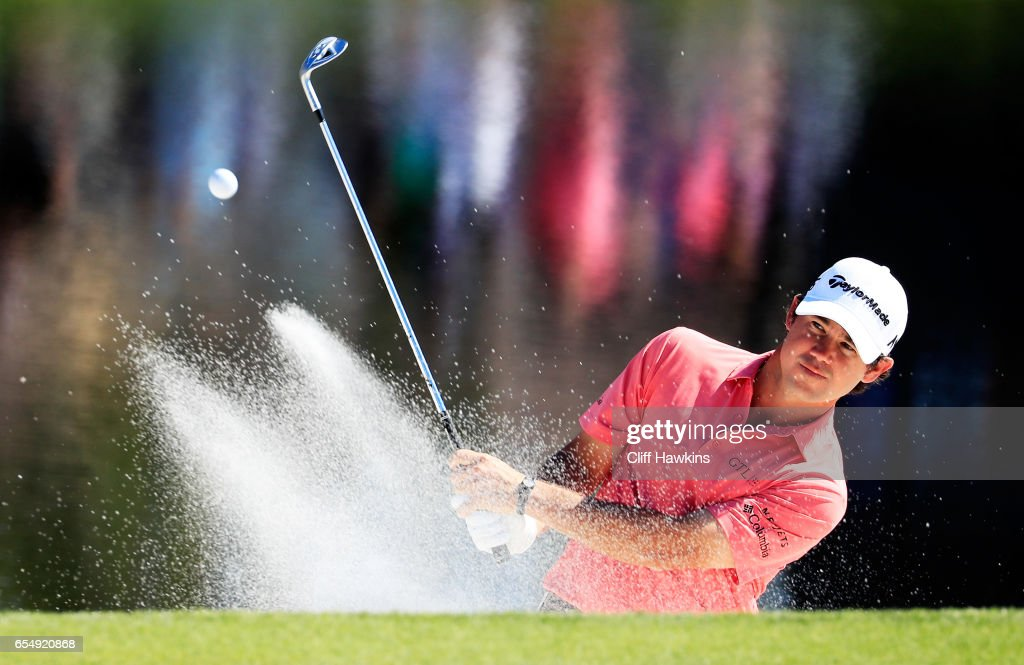 Brian Harman of the United States plays a shot from a bunker on the 17th hole during the third round of the Arnold Palmer Invitational Presented By MasterCard at Bay Hill Club and Lodge on March 18, 2017 in Orlando, Florida.