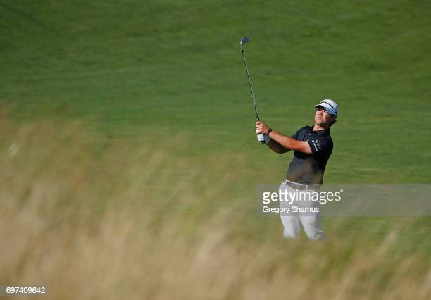 Brian Harman of the United States plays his shot on the 12th hole during the final round of the 2017 US Open at Erin Hills on June 18 2017 in...