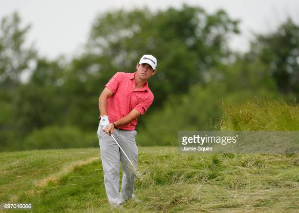 Brian Harman of the United States plays his shot on the 17th hole during the third round of the 2017 US Open at Erin Hills on June 17 2017 in...