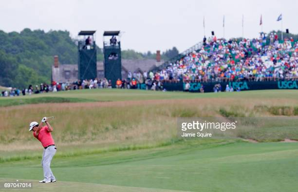 Brian Harman of the United States plays his shot on the 18th hole during the third round of the 2017 US Open at Erin Hills on June 17 2017 in...