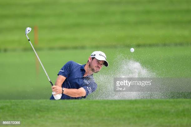 Brian Harman of the United States plays his shot out of the bunker on the 2nd hole during the first round of the WGC HSBC Champions at Sheshan...