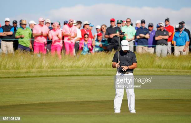 Brian Harman of the United States reacts after missing a putt on the 11th green during the final round of the 2017 US Open at Erin Hills on June 18...
