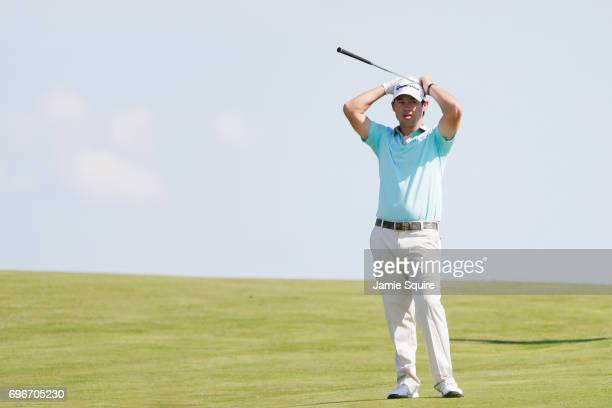Brian Harman of the United States reacts after playing his shot on the tenth hole during the second round of the 2017 US Open at Erin Hills on June...