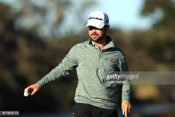 Brian Harman of the United States reacts after putting on the 18th green during the final round of The RSM Classic at Sea Island Golf Club Seaside...
