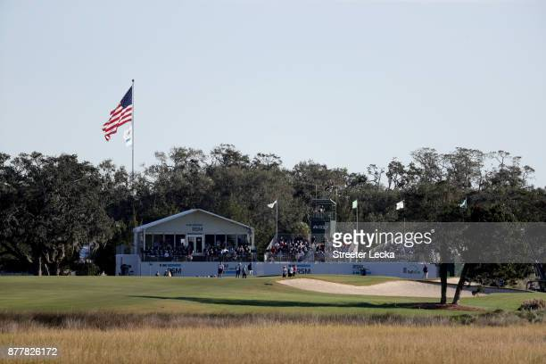 Brian Harman of the United States Stephan Jaeger of Germany and Ted Potter jr of the United States stand on the 18th green during the final round of...