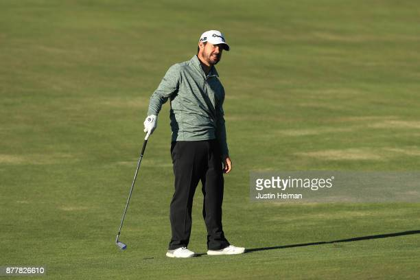 Brian Harman of the United States watches his second shot on the 18th hole during the final round of The RSM Classic at Sea Island Golf Club Seaside...