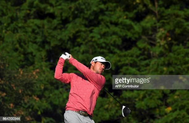 Brian Harman of the US tees off on the 3rd hole during the third round of the CJ Cup at Nine Bridges in Jeju Island on October 21 2017 / AFP PHOTO /...
