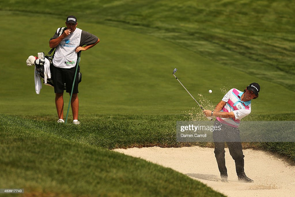 Brian Harman plays his second shot from the bunker on the 10th hole during the first round of The Barclays at The Ridgewood Country Club on August 21, 2014 in Paramus, New Jersey.