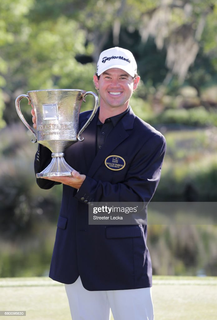 Brian Harman poses with the trophy after winning the Wells Fargo Championship at Eagle Point Golf Club on May 7, 2017 in Wilmington, North Carolina.