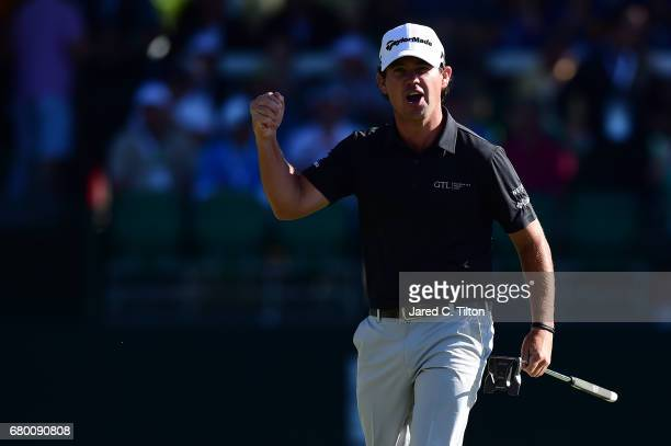 Brian Harman reacts after putting for birdie on the 18th green to win the Wells Fargo Championship at Eagle Point Golf Club on May 7 2017 in...