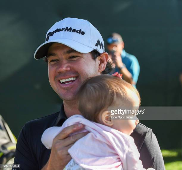Brian Harmon hugs his baby after sinking a long putt for the win during the final round of the Wells Fargo Championship at the Eagle Point Golf Club...