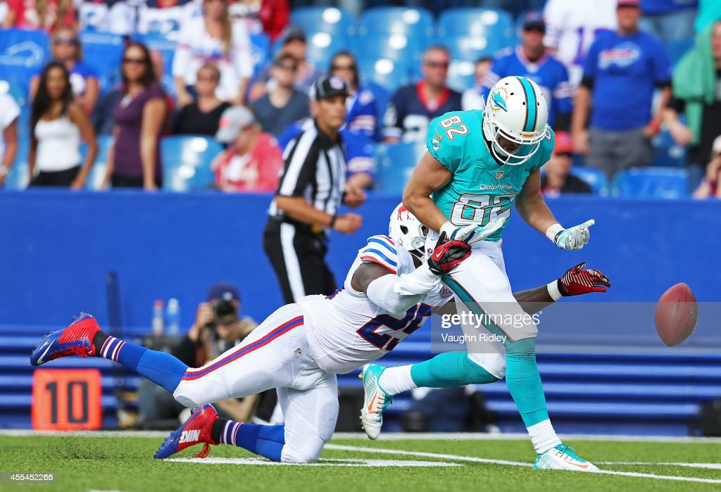Brian Hartline #82 of the Miami Dolphins has a pass broken up by Da'Norris Searcy #25 of the Buffalo Bills during the second half at Ralph Wilson Stadium on September 14, 2014 in Orchard Park, New York.