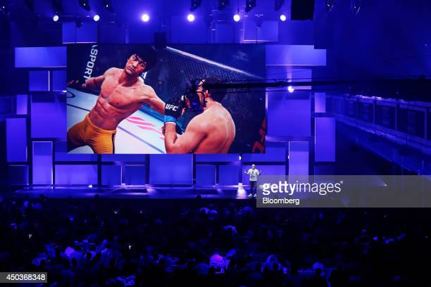 Brian Hayes creative director of EA Sports UFC at Electronic Arts Inc speaks as an image of martial arts icon Bruce Lee is displayed on an overhead...