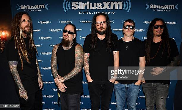 Brian 'Head' Welch Reginald 'Fieldy' Arvizu Jonathan Davis Ray Luzier and James 'Munky' Shaffer of Korn pose backstage at a private concert for...