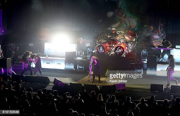 Brian 'Head' Welch Reginald 'Fieldy' Arvizu Jonathan Davis Ray Luzier and James 'Munky' Shaffer of Korn perform onstage at a private concert for...