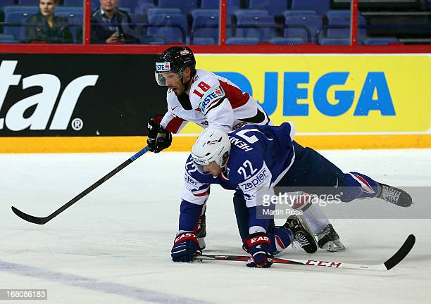 Brian Henderson of France and Thomas Koch of Austria battle for the puck during the IIHF World Championship group H match between France and Austria...