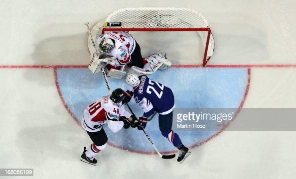 Brian Henderson of France fails toscore over Bernhard Starkbaum goaltender of Austria during the IIHF World Championship group H match between France...