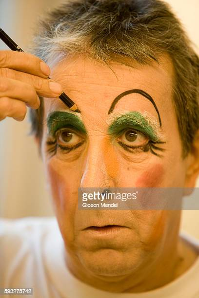 Brian Hibbard puts on his makeup as he prepares to be a pantomime dames playing the role of one of the Ugly Sisters in a production of Cinderella at...