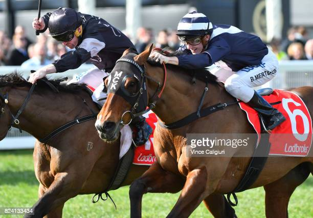 Brian Higgins riding Saint Valorem defeats Beau Mertens riding Tango Rock in Race 4 during Melbourne Racing at Caulfield Racecourse on July 29 2017...