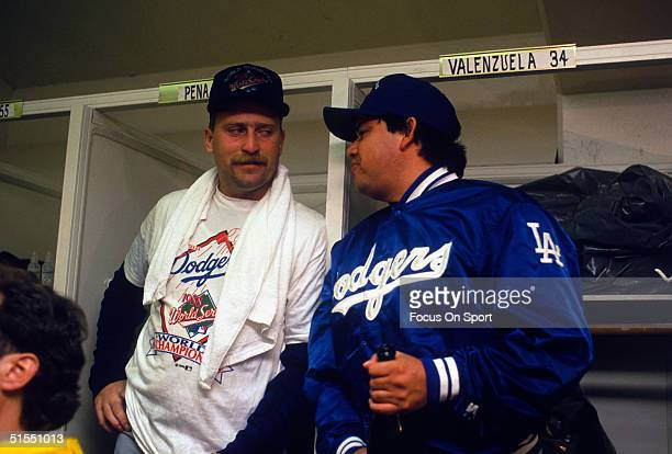Brian Holton and Fernando Valenzuela both pitchers for the Los Angeles Dodgers share a quiet moment in the victorious Dodgers Clubhouse during the...