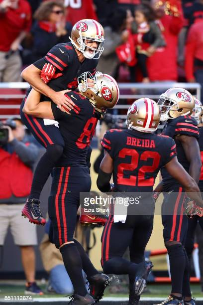 Brian Hoyer of the San Francisco 49ers celebrates after rushing for a touchdown in the first quarter against the Los Angeles Rams at Levi's Stadium...