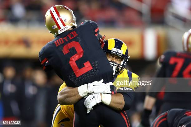 Brian Hoyer of the San Francisco 49ers is hit by Aaron Donald of the Los Angeles Rams during their NFL game at Levi's Stadium on September 21 2017 in...