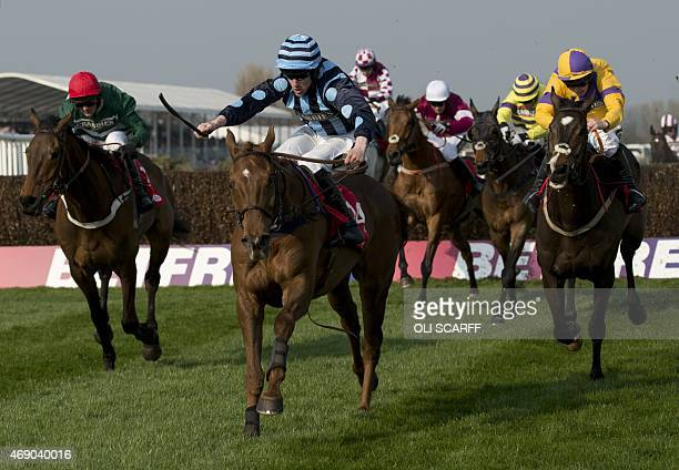 Brian Hughes riding 'Surf and Turf' heads on to win 'The Betfred Red Rum Handicap Steeple Chase' on the opening day of the Grand National Festival...