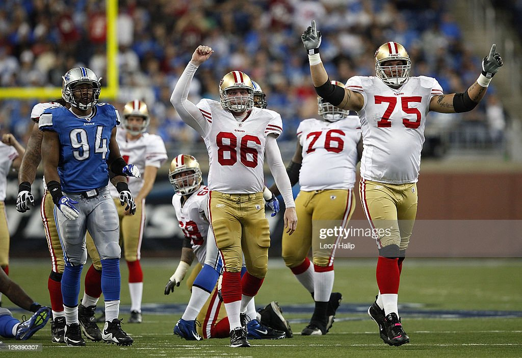 Brian Jennings and Alex Boone of the San Francisco 49ers celebrate David Akers 58 yard field goal to end the first half of the NFL game against the...