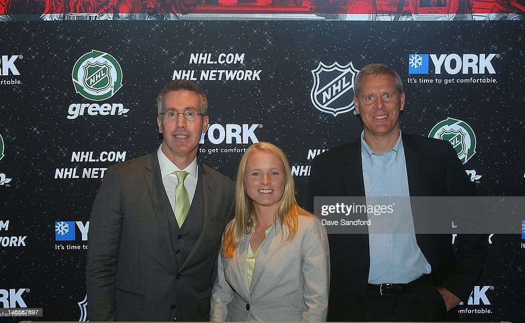 Brian Jennings NHL executive vice president of marketing poses with Melissa Marineau director of marketing for Johnson Controls Unitary Products and...