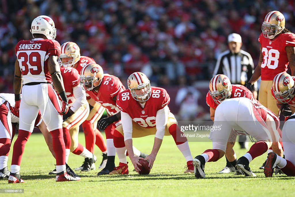 Brian Jennings of the San Francisco 49ers snaps the ball on a punt play during the game against the Arizona Cardinals at Candlestick Park on December...
