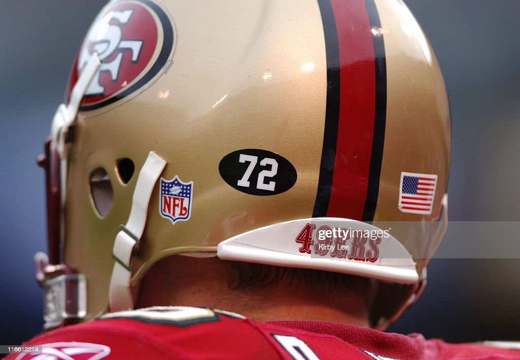 Brian Jennings of the San Francisco 49ers wears a black football shape decal with the No 72 in the memory of Thomas Herrion who collapsed and died in...