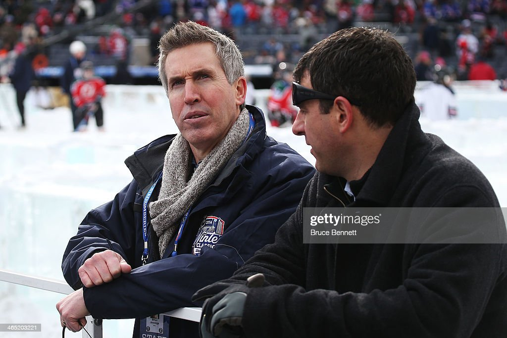 Brian Jennings the chief marketing officer of the NHL looks on prior to the 2014 Coors Light NHL Stadium Series game between the New York Rangers and...