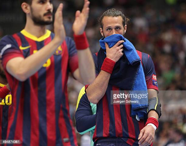 Brian Jesper Noeddesbo of Barcelona covers his face after the EHF Champions League semifinal match betwee FC Barcelona and SG Flensburg Handewitt at...