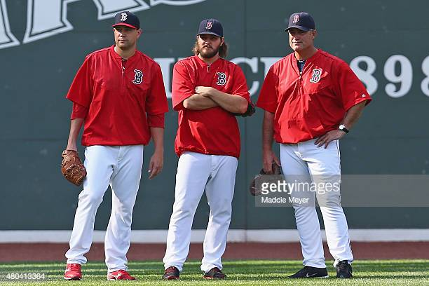Brian Johnson Wade Miley and John Farrell of the Boston Red Sox look on during batting practice before their game against the New York Yankees at...