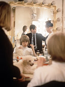 Brian Jones of the Rolling Stones backstage preparing for a performance 1964 There is a poodle on dressing table