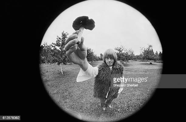 Brian Jones of The Rolling Stones Holding Mushroom