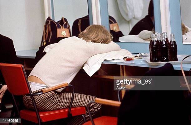 Brian Jones of The Rolling Stones taking a break backstage in the mid to late 1960s