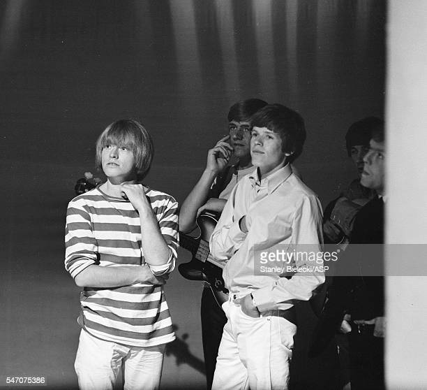 Brian Jones of the Rolling Stones with Karl Green and Peter Noone of Herman's Hermits backstage Top Of The Pops TV show London 1965