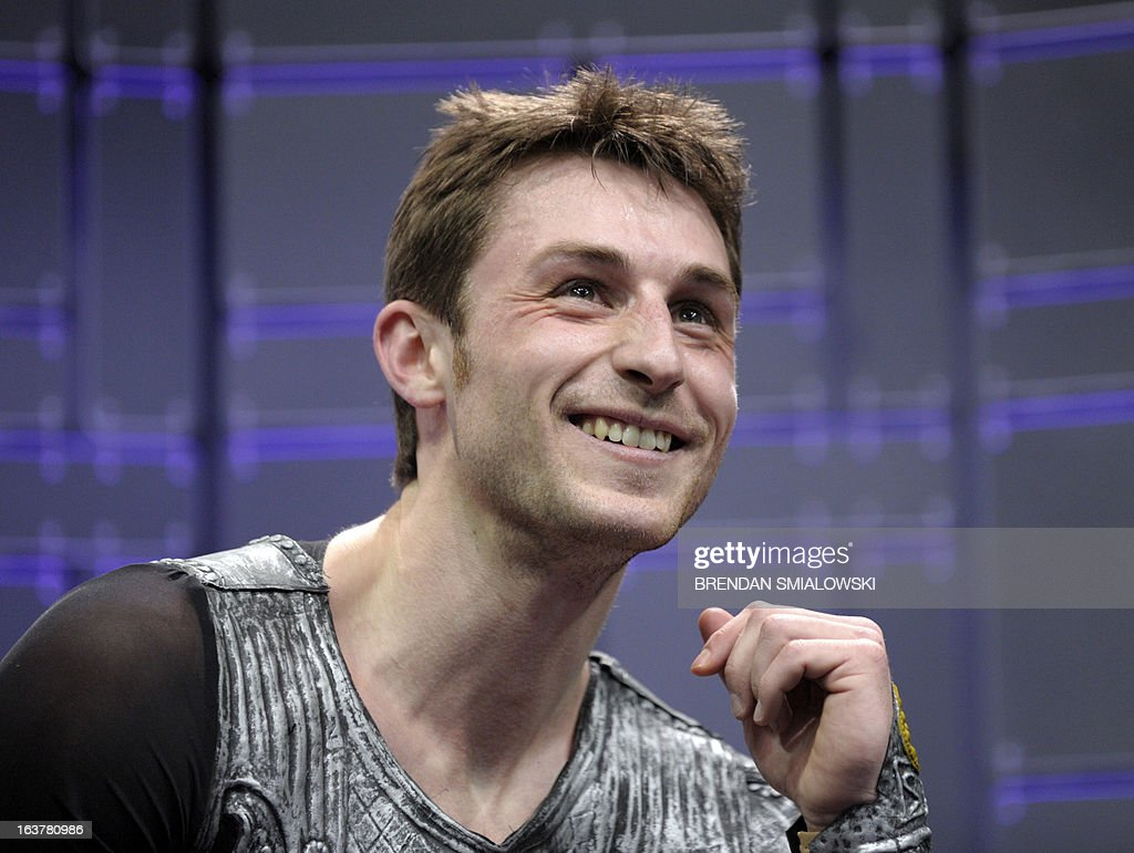 Brian Joubert competing for France reacts to his scores in the Men's Free Skate event at the 2013 World Figure Skating Championships March 15, 2013 in London, Ontario, Canada. AFP PHOTO/Brendan SMIALOWSKI