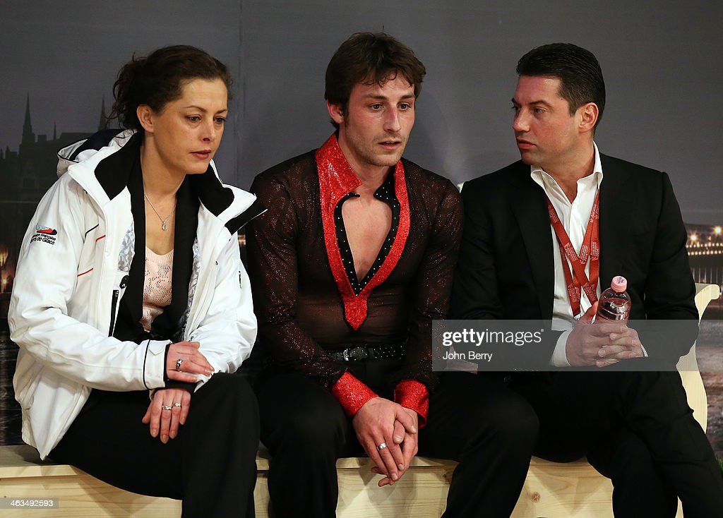 <a gi-track='captionPersonalityLinkClicked' href=/galleries/search?phrase=Brian+Joubert&family=editorial&specificpeople=213858 ng-click='$event.stopPropagation()'>Brian Joubert</a> of France with his coach Veronique Guyon and his choregrapher <a gi-track='captionPersonalityLinkClicked' href=/galleries/search?phrase=Nikolai+Morozov+-+Figure+Skater&family=editorial&specificpeople=4209073 ng-click='$event.stopPropagation()'>Nikolai Morozov</a> react to the results during the Men Free Skating event of the ISU European Figure Skating Championships 2014 held at the Syma Hall stadium on January 18, 2014 in Budapest, Hungary.