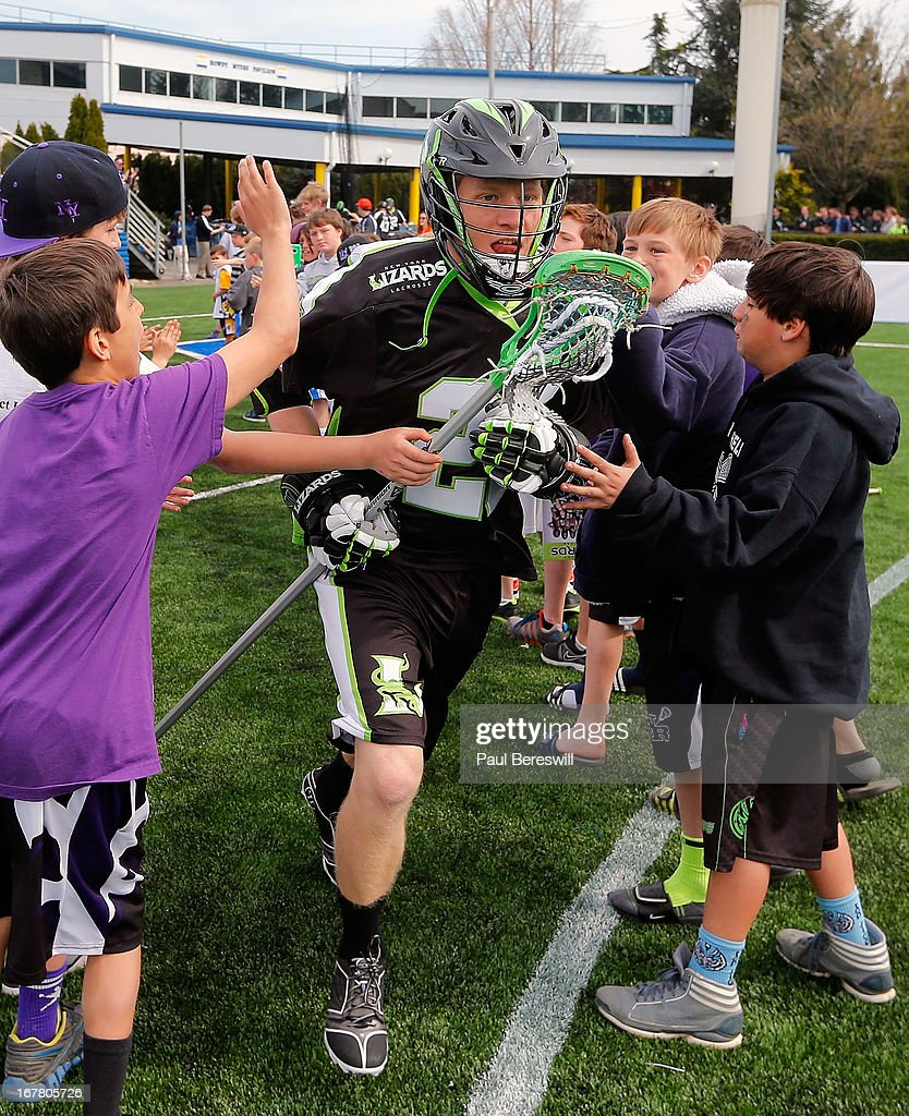 Brian Karalunas #25 of the New York Lizards runs onto the field as he is introduced perior to a Major League Lacrosse game against the Boston Cannons at James M. Shuart Stadium on April 28, 2013 in Hempstead, New York.