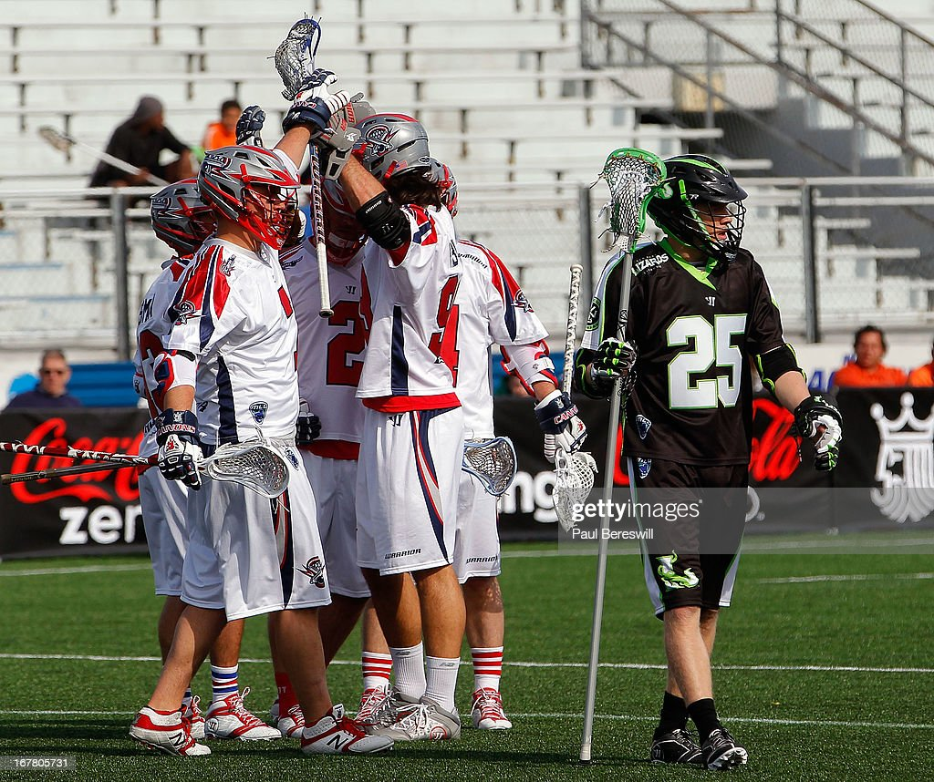Brian Karalunas #25 of the New York Lizards walks away as members of the Boston Cannons celebrate a goal during a Major League Lacrosse game at James M. Shuart Stadium on April 28, 2013 in Hempstead, New York.